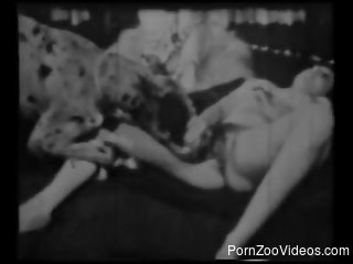 Beautiful woman has fun with doggy in vintage bestiality clip